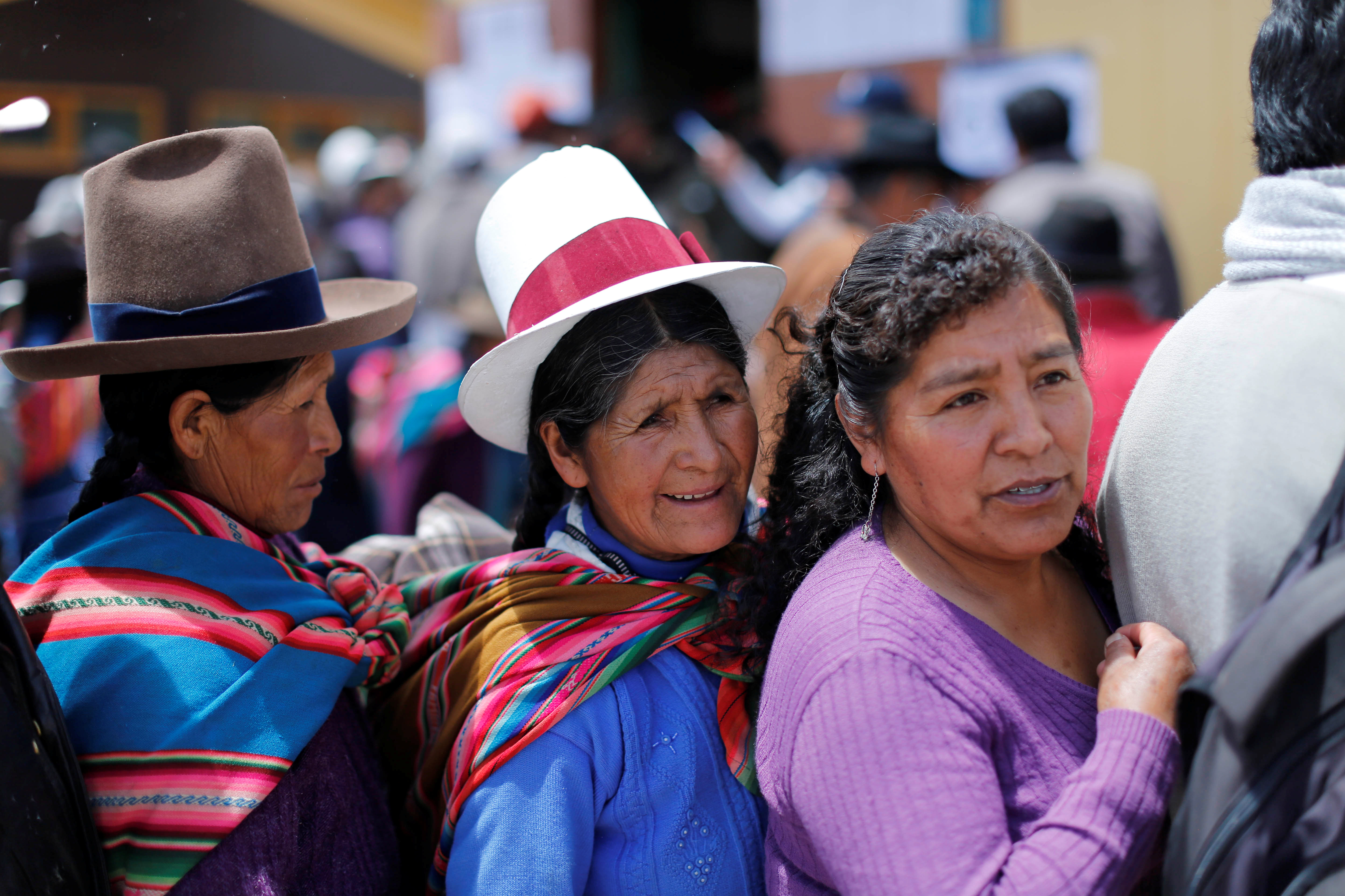Women wait in line to vote during Peruvian municipal and regional elections in Cuzco