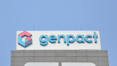The logo of Genpact is seen on the facade of its building in Bengaluru