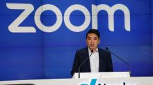 Eric Yuan, CEO of Zoom Video Communications takes part in a bell ringing ceremony at the NASDAQ MarketSite in New York