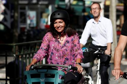Mayor of Paris Anne Hidalgo rides a Velib Metropole self-service public bike by Smovengo on the newly created secure bicycle facilities in Paris, France, September 4, 2019.