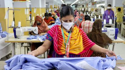A woman works in a garment factory, as factories reopened after the government has eased the restrictions amid concerns over coronavirus disease (COVID-19) outbreak in Dhaka, Bangladesh