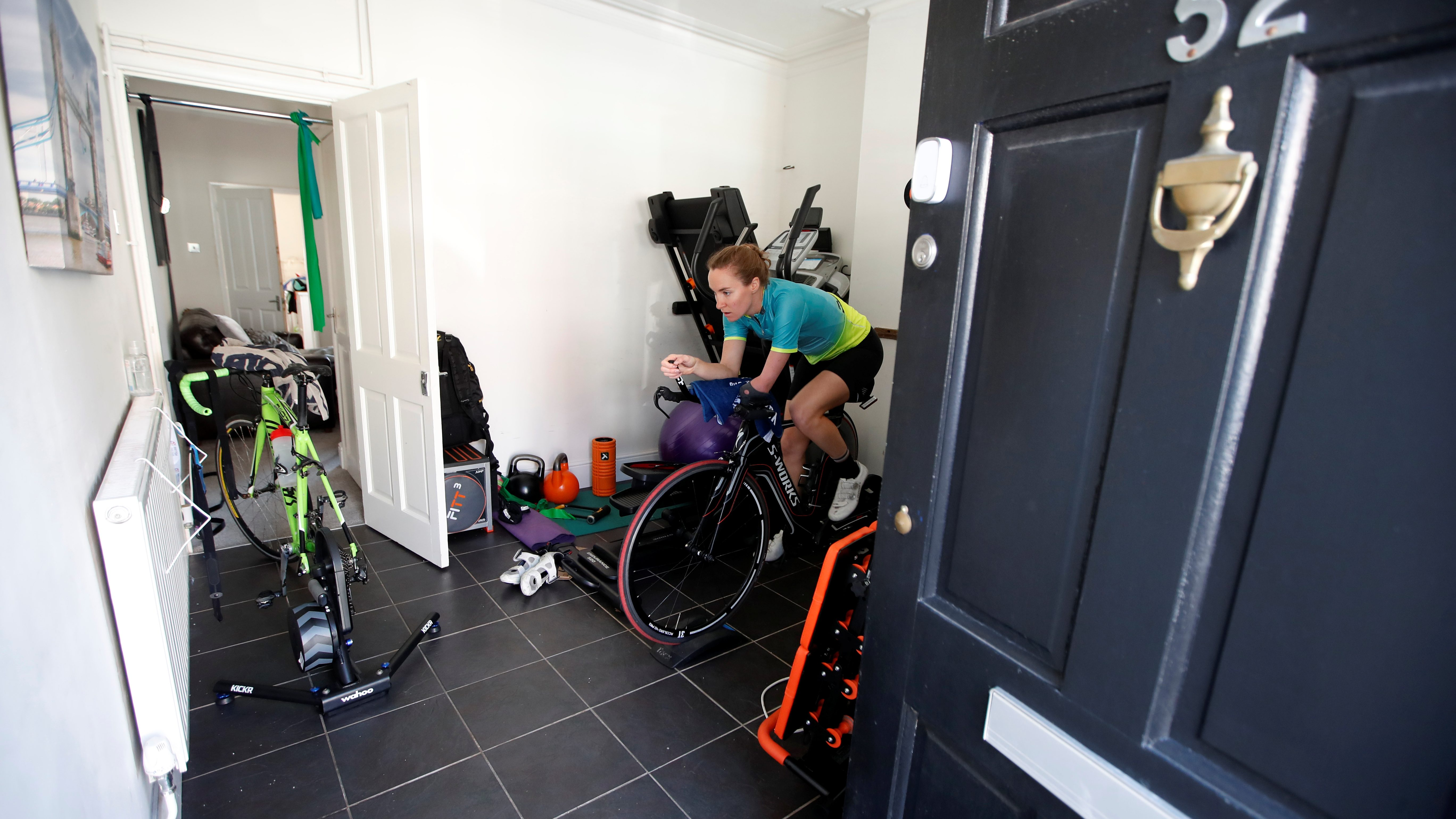 Team GB paratriathlete Claire Cashmore on a stationary bike during a training session following the outbreak of the coronavirus disease.