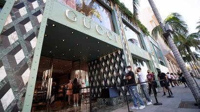 Shoppers stand in line wearing face masks outside the Gucci store during the outbreak of the coronavirus disease (COVID-19), in Beverly Hills, California