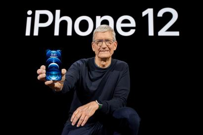 Apple CEO Tim Cook poses with the all-new iPhone 12 Pro at Apple Park in Cupertino, California, U.S. in a photo released October 13, 2020.