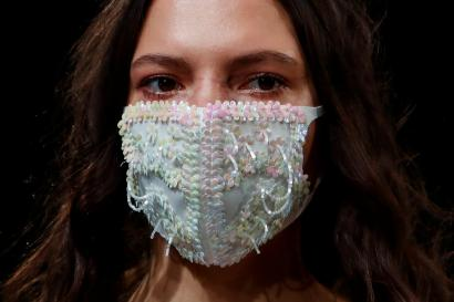 A model presents a face mask, a creation by 050 brand during Mercedes-Benz Fashion Week Russia amid the coronavirus disease (COVID-19) outbreak in Moscow