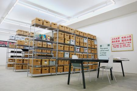 Shelves filled with cardboard boxes of items from the archives of the Museum of Chinese in America in its new research center space in New York City.