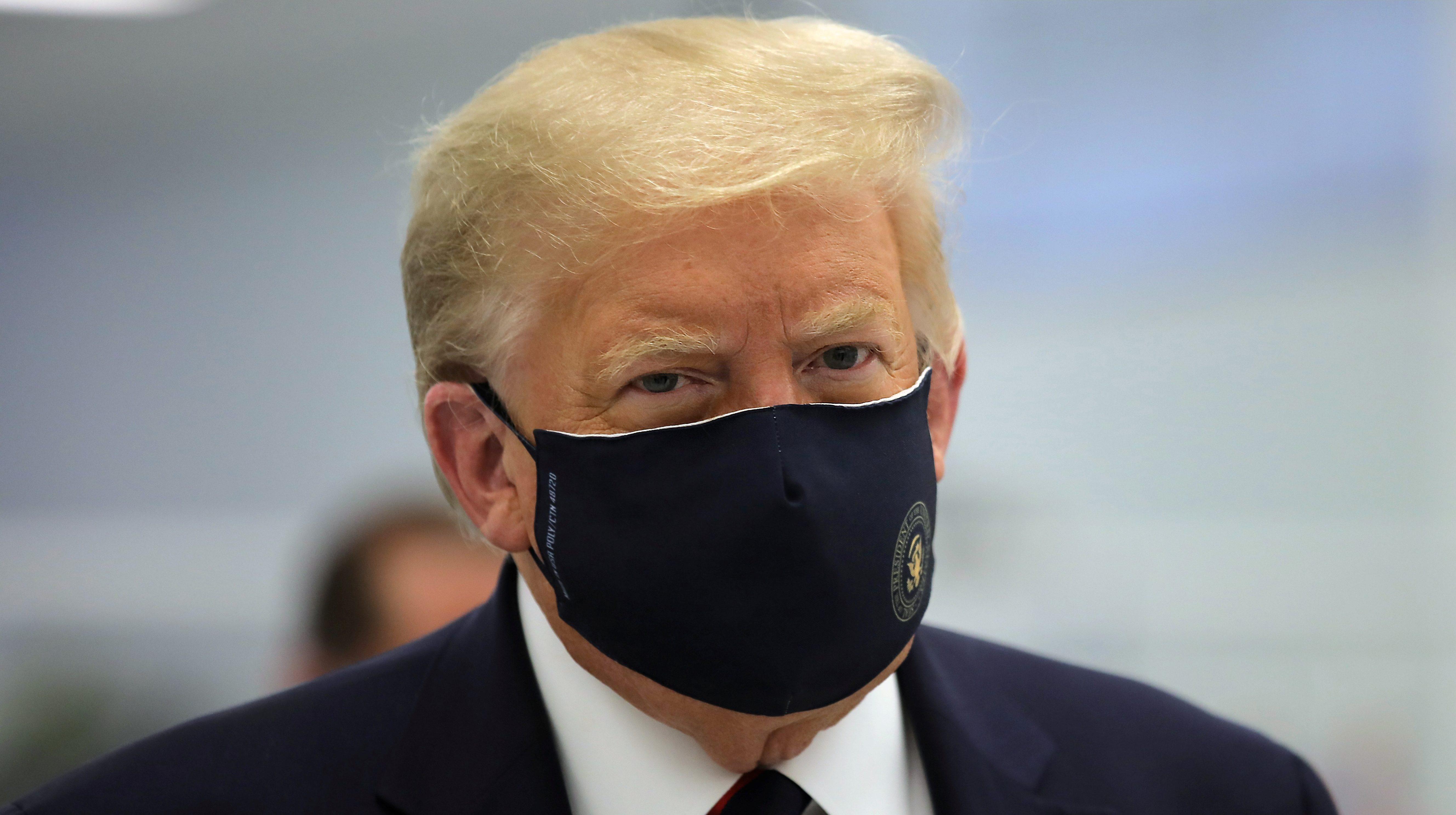 Donald Trump wears a mask