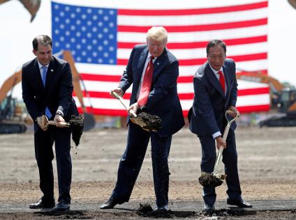 U.S. President Donald Trump takes part in a groundbreaking with Wisconsin Governor Scott Walker (L) and Foxconn Chairman Terry Gou (R) during a visit to Foxconn's new site in Mount Pleasant, Wisconsin, U.S., June 28, 2018.