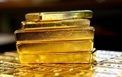 Several stacked gold bars.