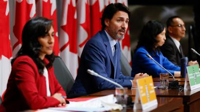 Canada's Prime MinisterJustin Trudeau, with trusted officials: Dr. Theresa Tam, Canada's Chief Public Health Officer (right) and Anita Anand (left), minister of public services and procurement.