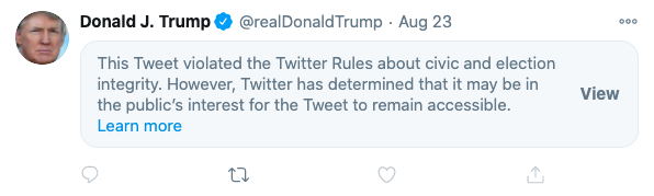A tweet from Donald Trump is obscured by a warning label, which tells users the tweet violates Twitter's rules but gives them the option to see it anyway.