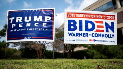 Yard signs supporting U.S. President Donald Trump and Democratic U.S. presidential nominee and former Vice President Joe Biden are seen outside of an early voting site.