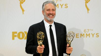 Jon Stewart holds his awards during the 67th Primetime Emmy Awards in Los Angeles