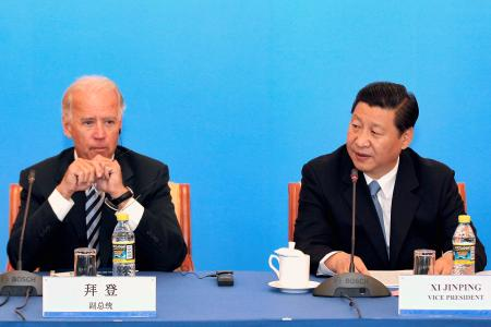 China's Vice President Xi Jinping (R) speaks next to U.S. Vice President Joe Biden during a discussion with U.S. and Chinese business leaders at Beijing Hotel in Beijing August 19, 2011.