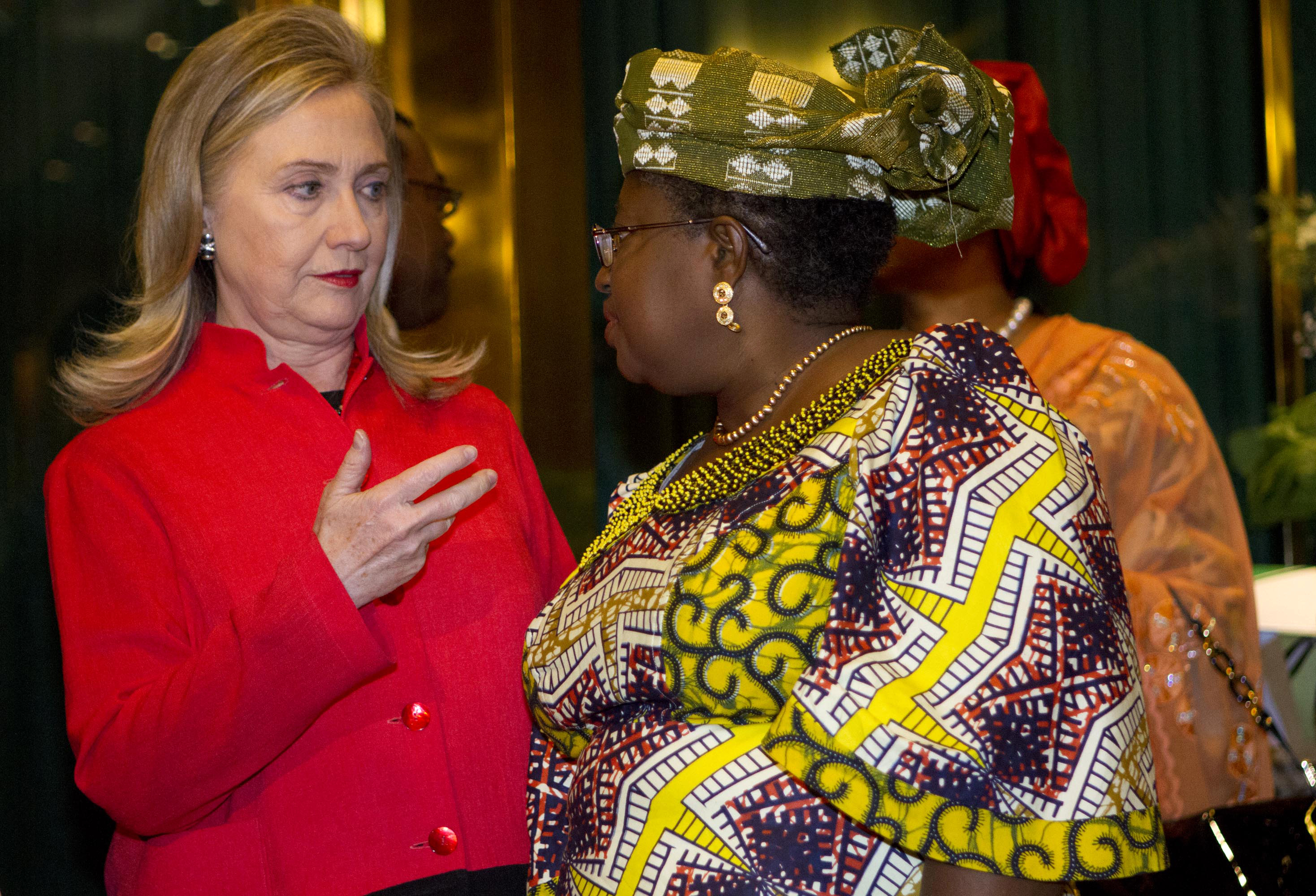 U.S. Secretary of State Clinton talks with Nigerian Finance Minister Okonjo-Iweala at the Presidential Villa in Abuja