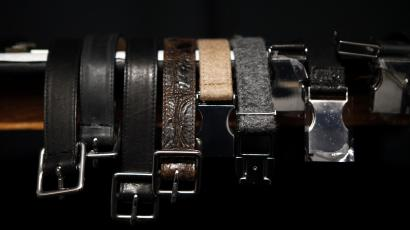 A display of hanging belts