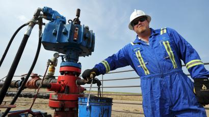 Oil company worker with a rig.