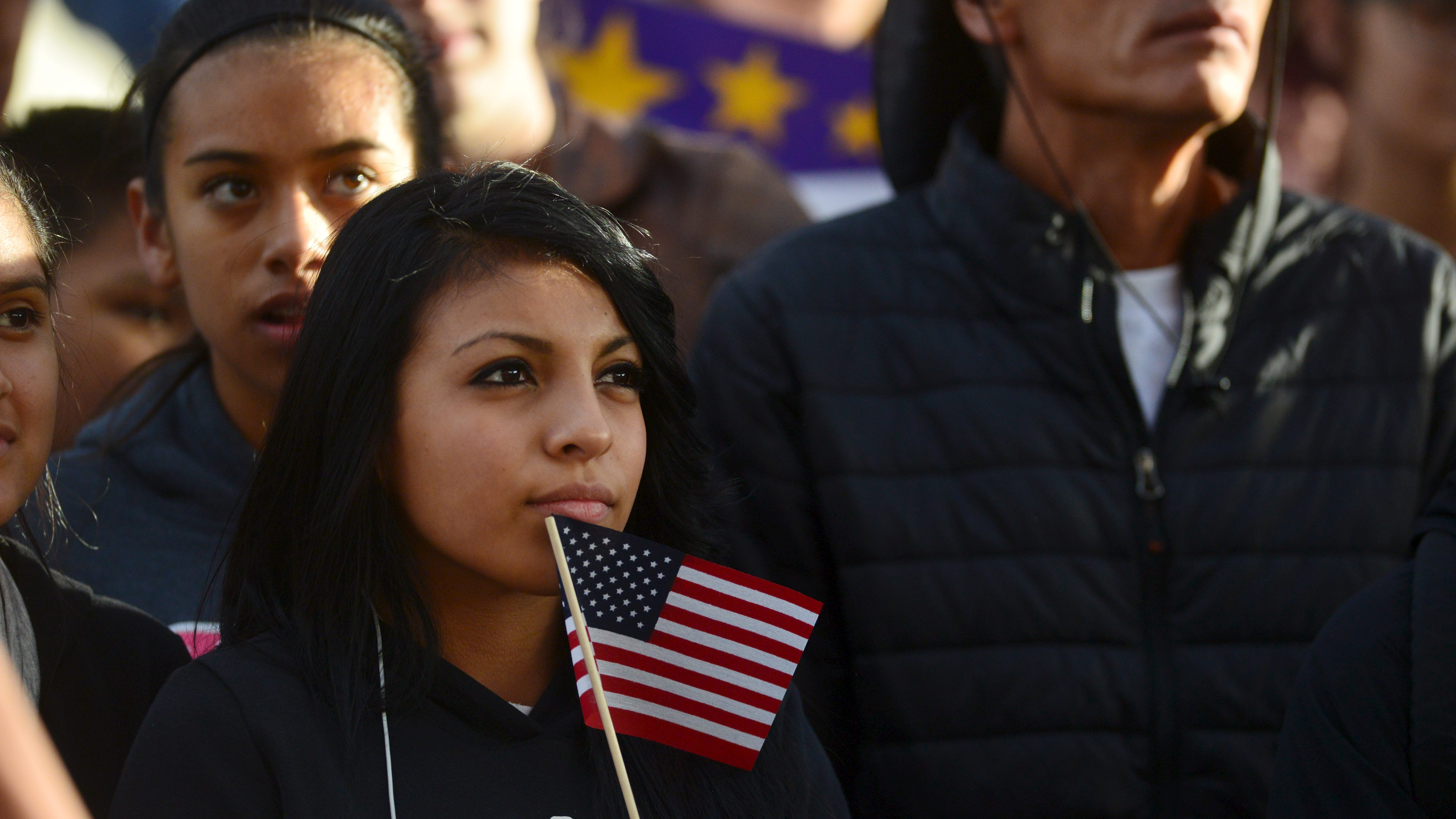 Latino leaders and immigration reform supporters gather at Farrand Field on the campus of the University of Colorado