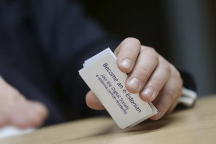Estonias government chief information officer Kotka holds cards to promote e-residency in Tallin
