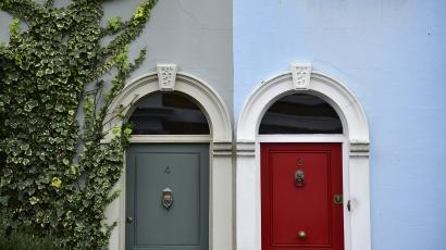 Painted property fronts are seen in a residential street in London
