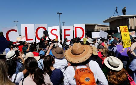 People protest against the Trump administration policy of separating immigrant families suspected of illegal entry, in front of the U.S. Customs and Border Protection building in El Paso, Texas, U.S., June 19, 2018. People protest against the Trump administration policy of separating immigrant families suspected of illegal entry, in front of the U.S. Customs and Border Protection building in El Paso, Texas, U.S., June 19, 2018.
