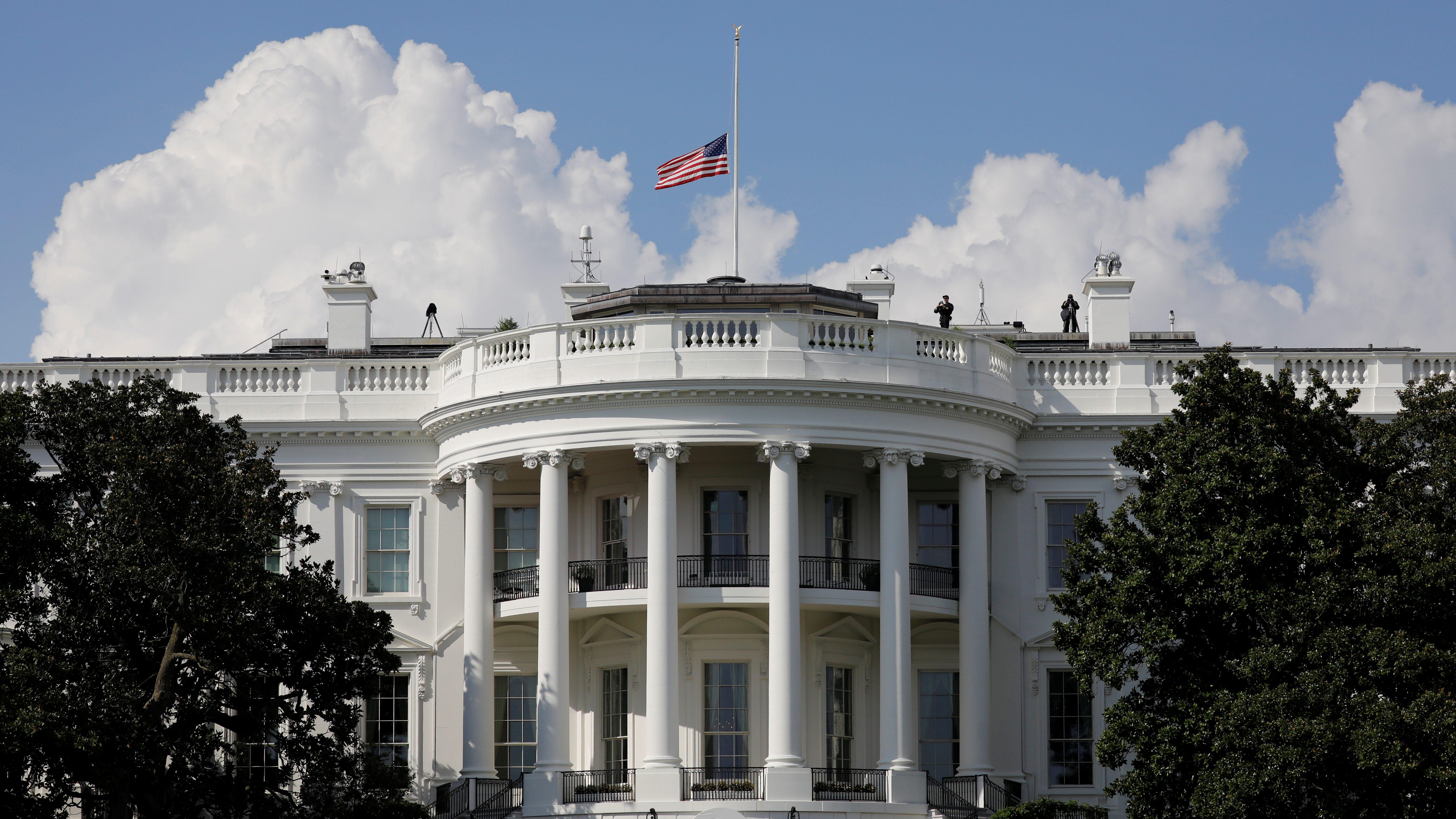 White House flag at half-mast.
