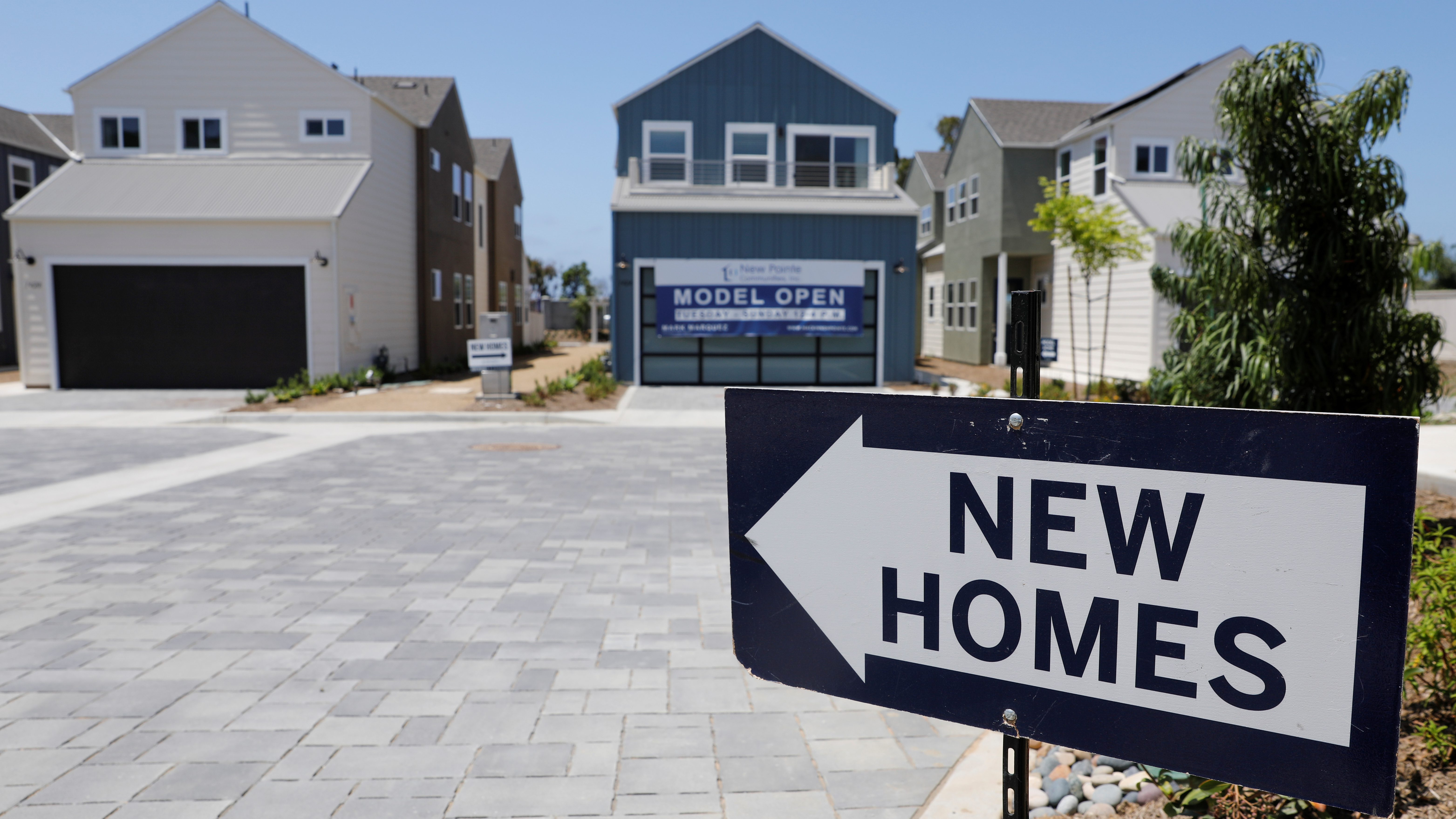 Newly constructed single family homes are shown for sale.