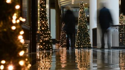 People walk past Christmas decorations in a department store ahead of the Christmas celebrations in Berlin, Germany.