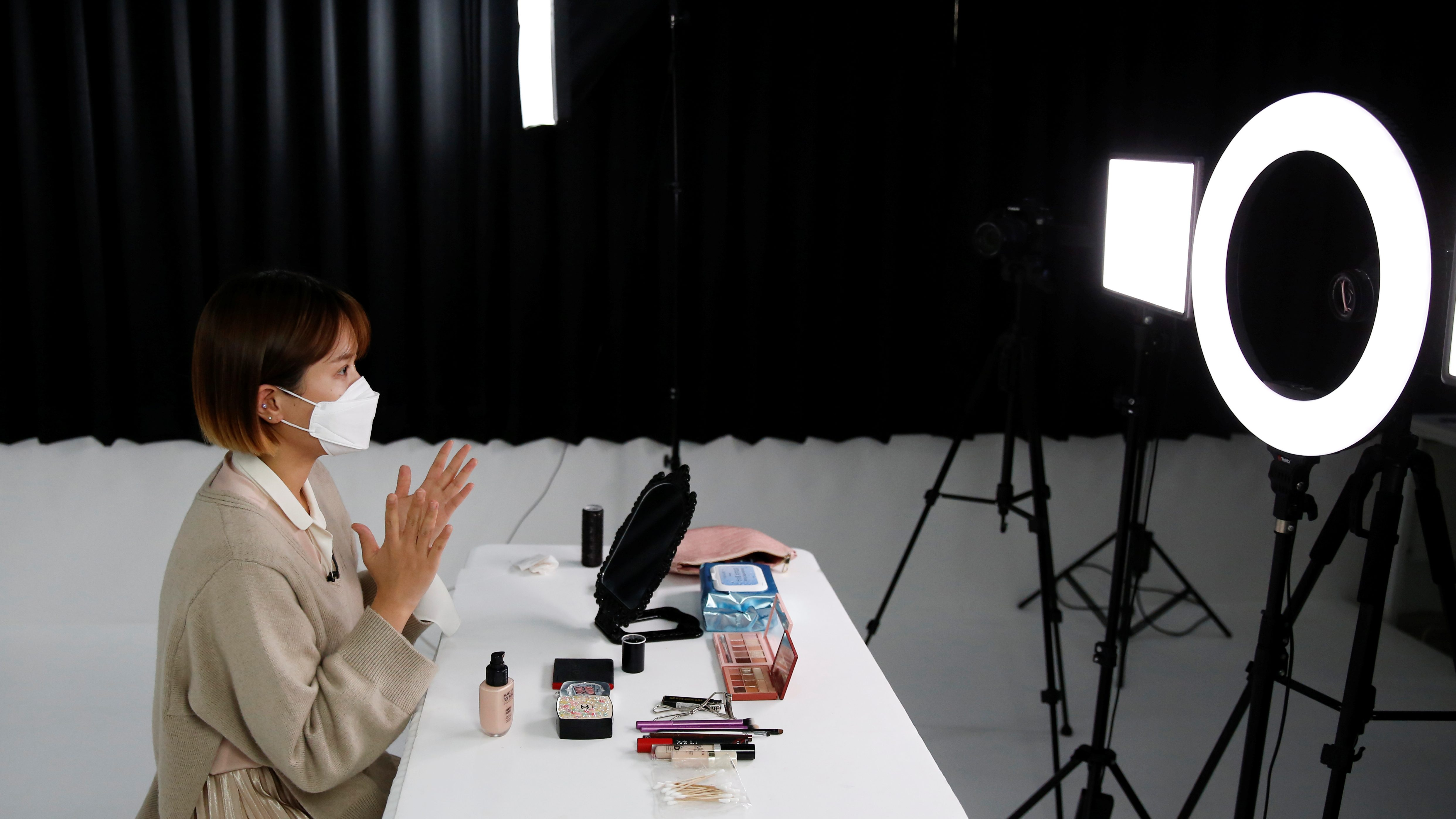 SSUNZY, a beauty content YouTuber, records YouTube video clips on makeup tutorials catered to those wearing masks, following the outbreak of the coronavirus disease (COVID-19), at a studio in Seoul, South Korea, March 17, 2020. Picture taken on March 17, 2020.