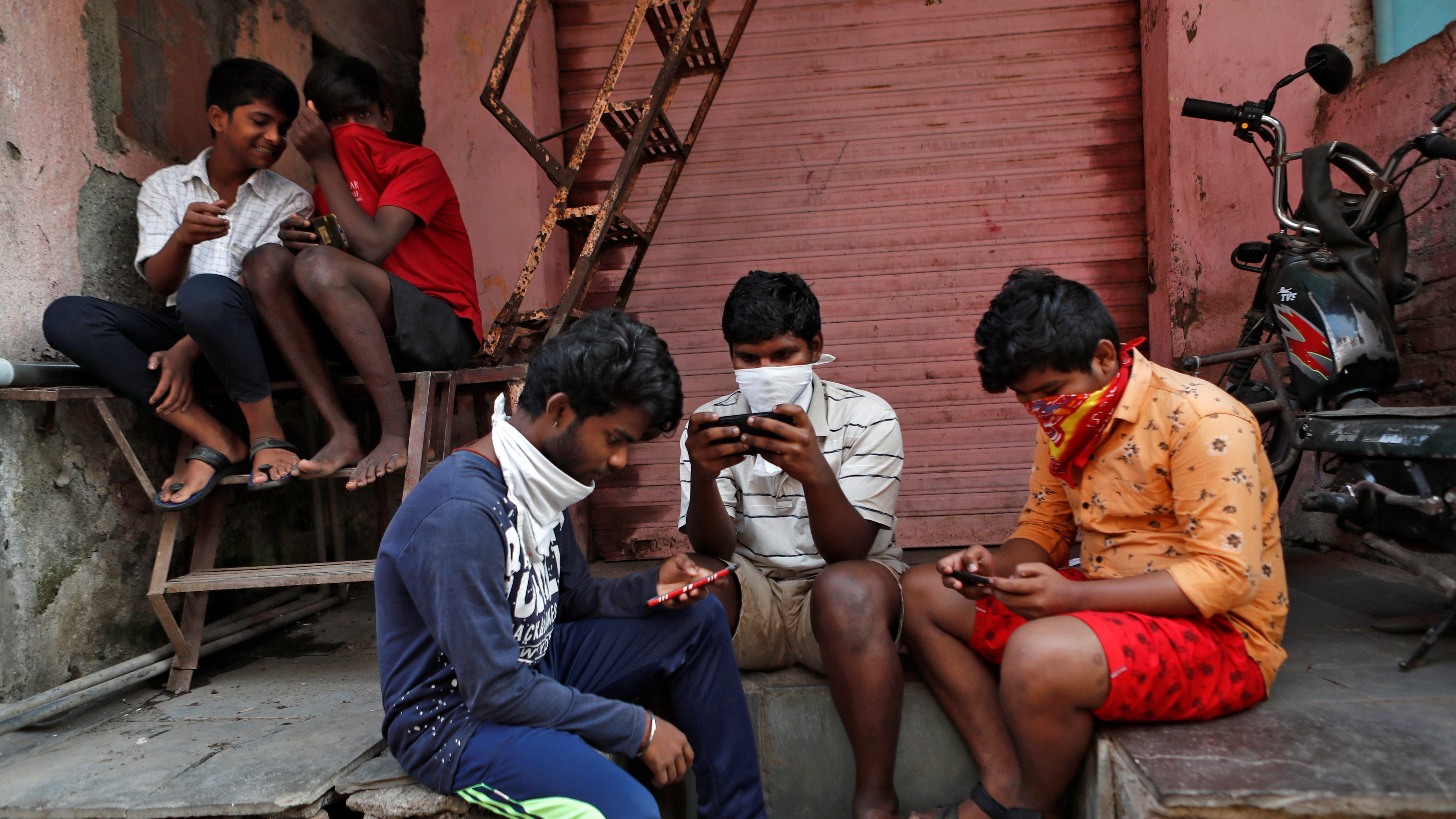 The Wider Image: Indians build their own lockdown barricades in the country's slums
