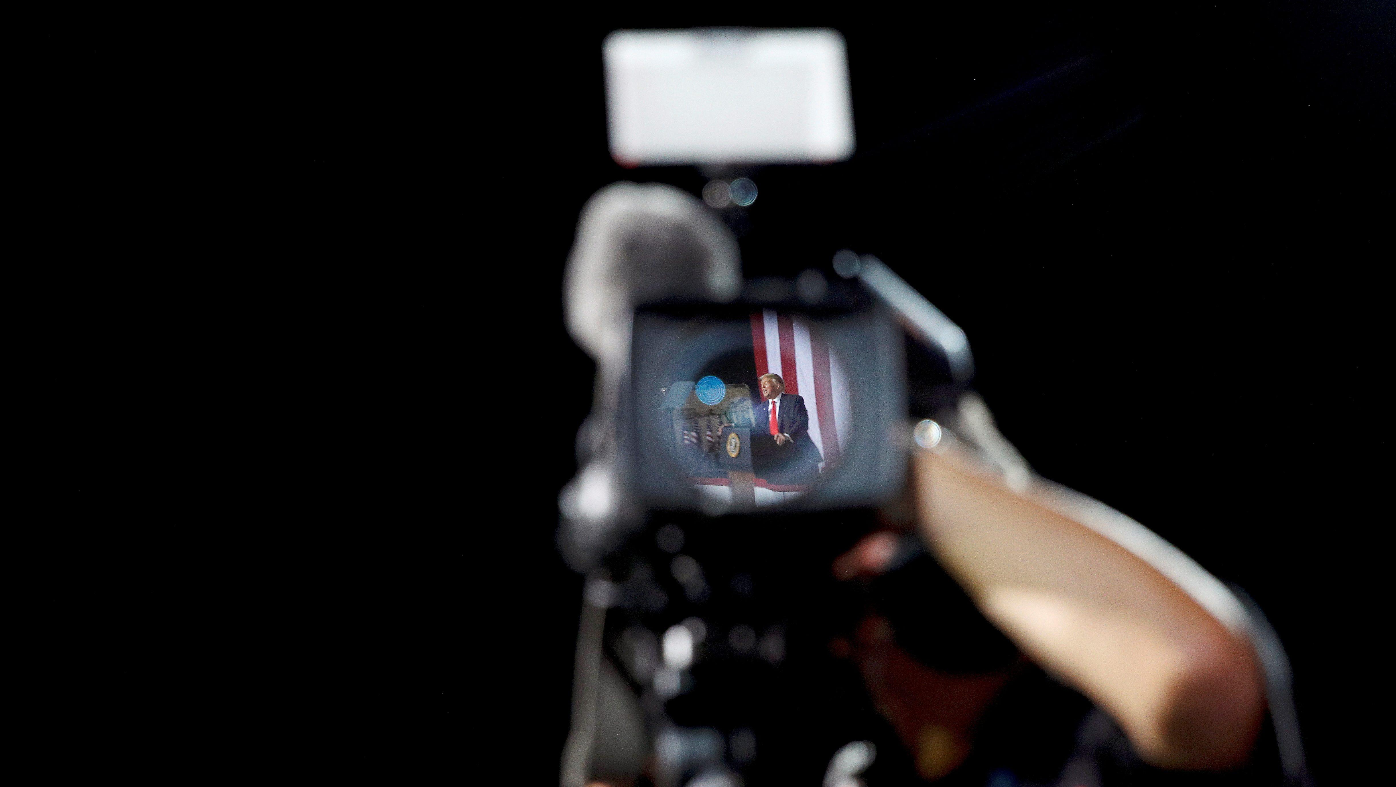 A video camera captures an image of Donald Trump at a rally in North Carolina.