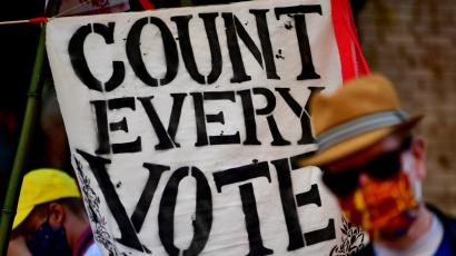 """A banner states """"COUNT EVERY VOTE"""" after Democratic presidential nominee Joe Biden overtook President Donald Trump in the Pennsylvania general election vote count in Philadelphia"""