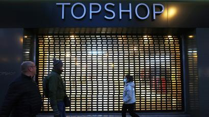 Pedestrians walk past a Topshop store, owed by Arcadia group on Oxford street in London, Britain, November 30, 2020