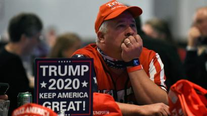 U.S. President Donald Trump supporter watches the 2020 U.S. presidential election results come in on Fox News at the DoubleTree Hotel in Bloomington, Minnesota, U.S.