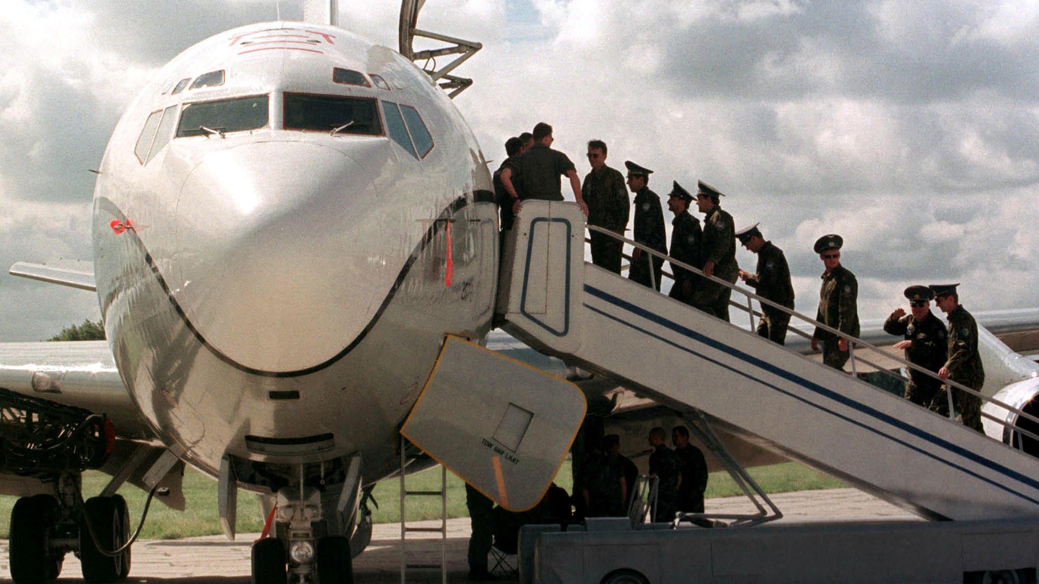 UKRAINIAN OFFICERS ENTER THE U.S. OBSERVATION AIRCRAFT IN KIEV.
