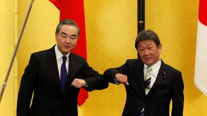 China's State Councilor and Foreign Minister Wang Yi (L) meets with his Japanese counterpart Toshimitsu Motegi, amid the coronavirus disease (COVID-19) outbreak, in Tokyo, Japan, November 24, 2020.