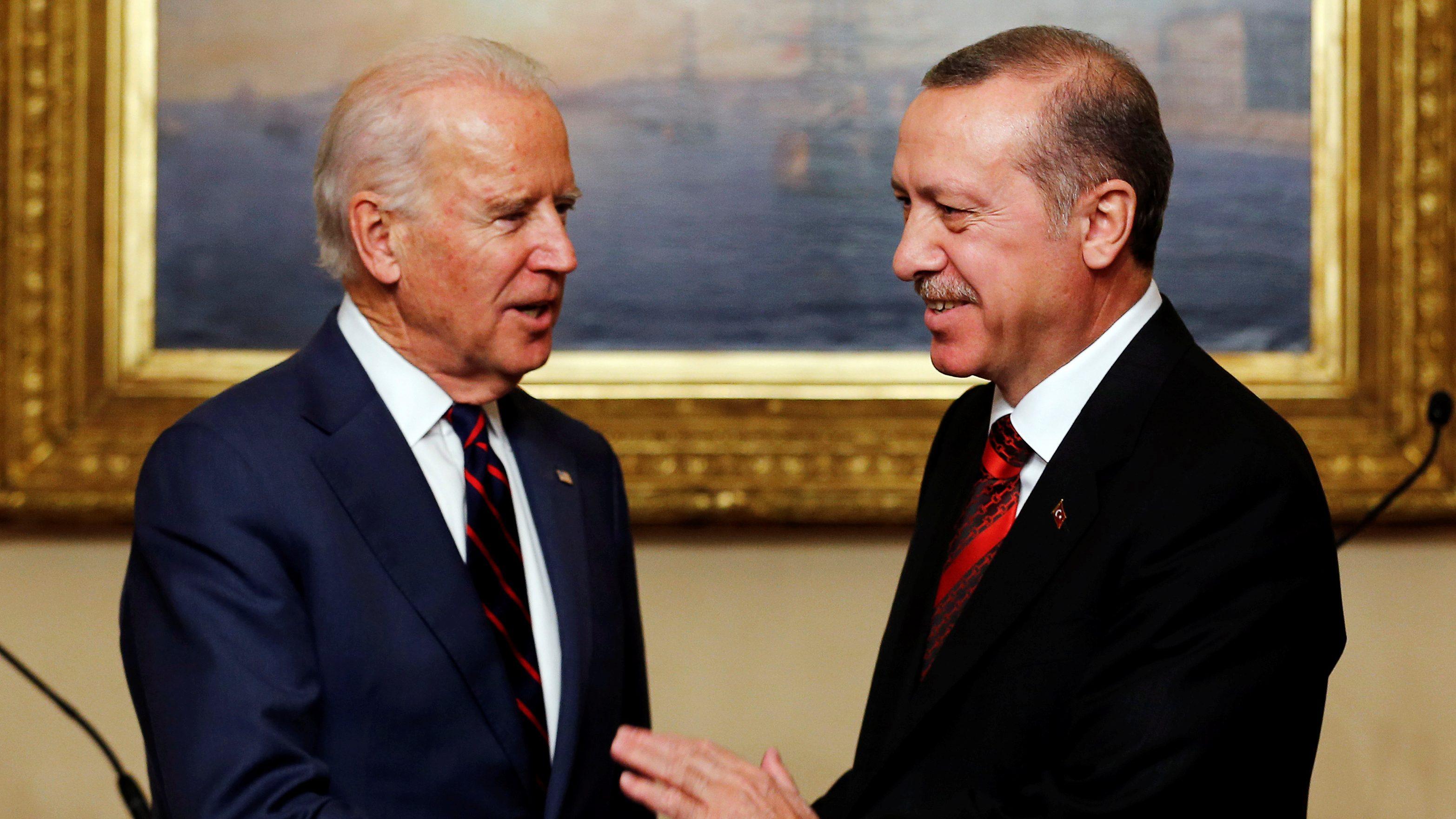 Joe Biden shakes hands with Erdogan