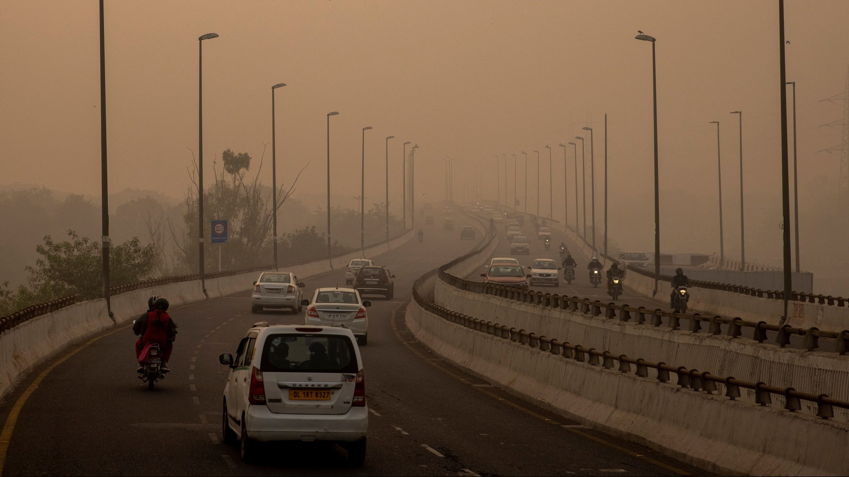 Traffic moves on a smoggy morning in New Delhi, India, November 9, 2020.