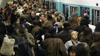 A crowded subway entrance in Paris.