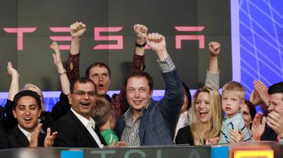 CEO of Tesla Motors Elon Musk waves after ringing the opening bell at the NASDAQ market in celebration of his company's initial public offering in New York June 29, 2010.