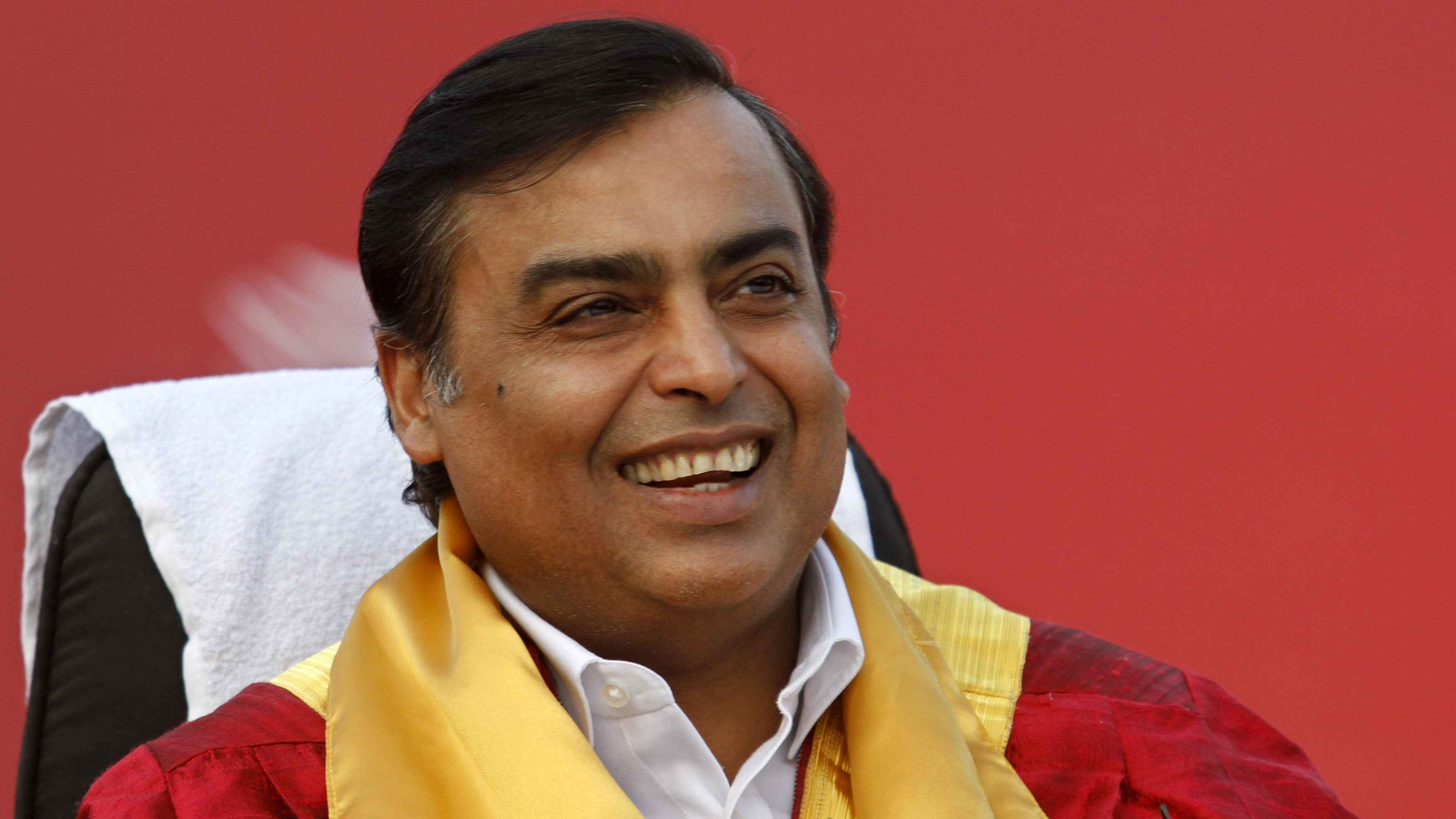 Mukesh Ambani, chairman of Reliance Industries Limited, smiles during a convocation ceremony at Pandit Deendayal Petroleum University (PDPU), a school of petroleum management at Gandhinagar in the western Indian state of Gujarat September 27, 2011. REUTERS/Amit Dave (INDIA - Tags: EDUCATION BUSINESS)