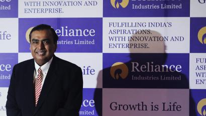 Mukesh Ambani, chairman of Reliance Industries Limited, poses for photographers before addressing the annual shareholders meeting in Mumbai June 6, 2013.