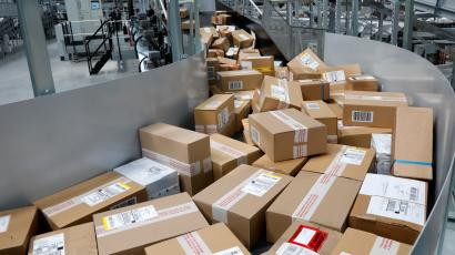 A conveyor belt full of packages at a UPS hub