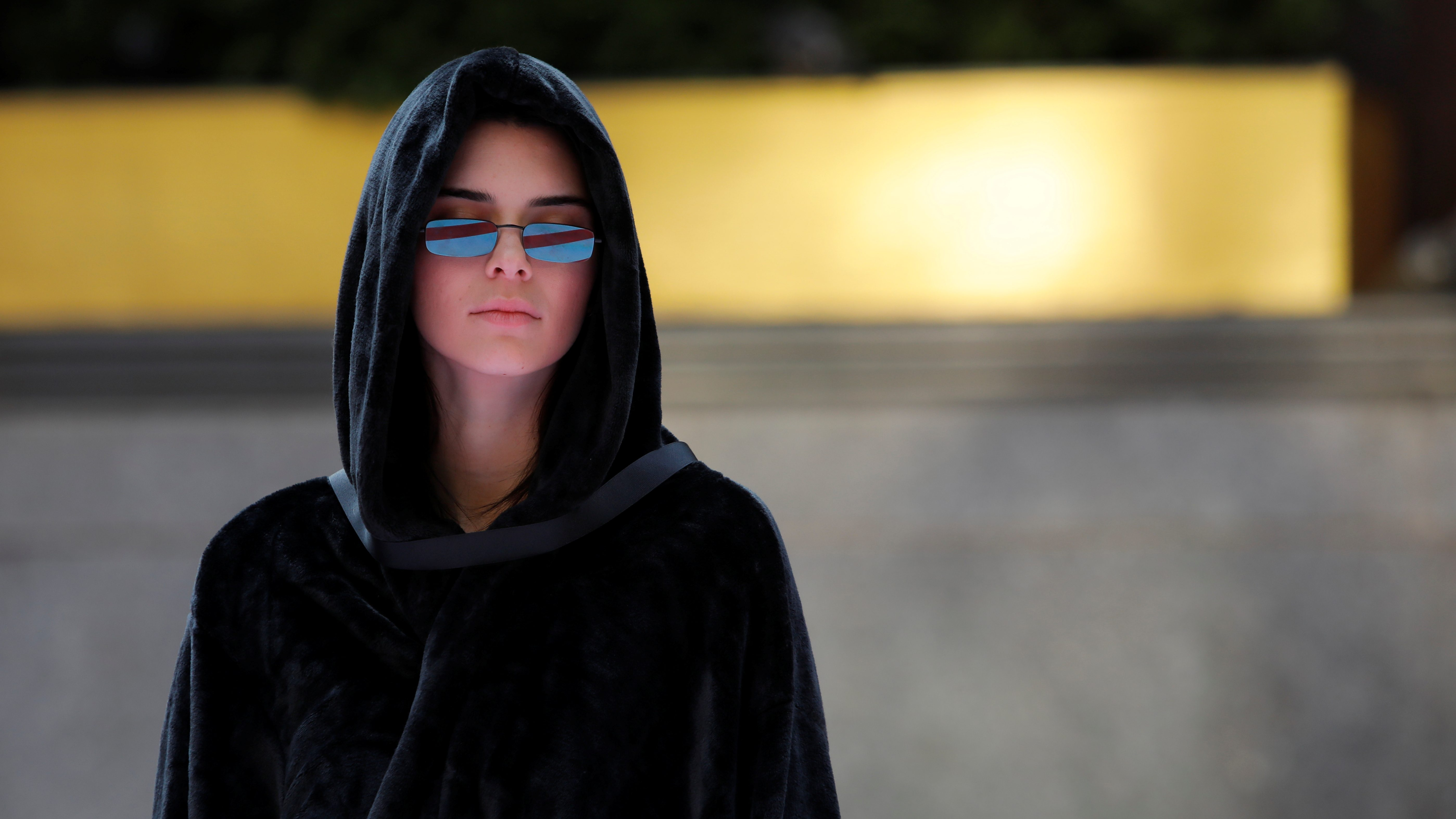 "Model Kendall Jenner walks the runway in a hooded cloak during rehearsals for the presentation of Alexander Wang's ""AW Collection 1"""