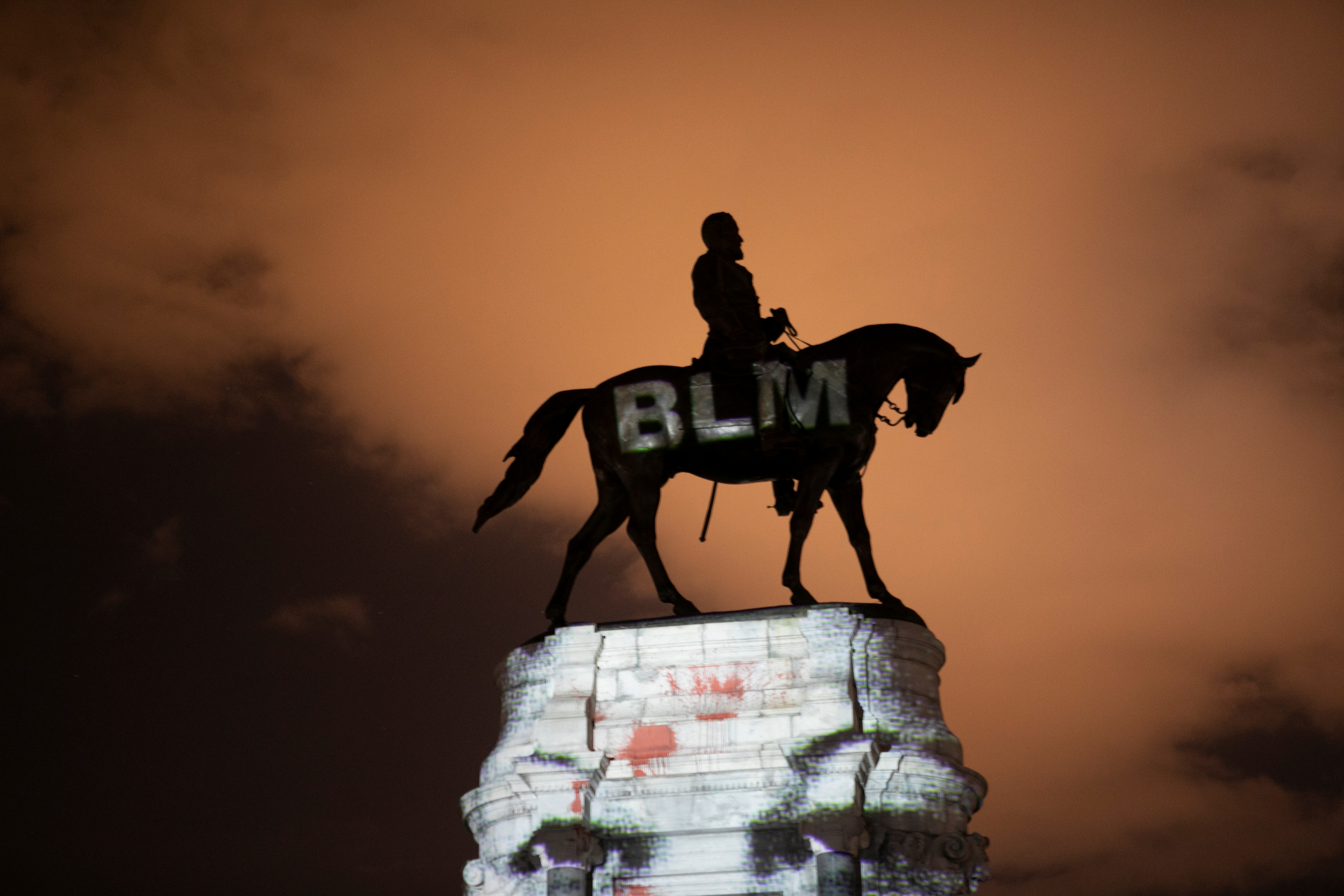 Artist Dustin Klein projects a Black Lives Matter image onto the statue of Confederate General Robert E. Lee in Richmond, Virginia, U.S. June 18, 2020. REUTERS/Julia Rendleman