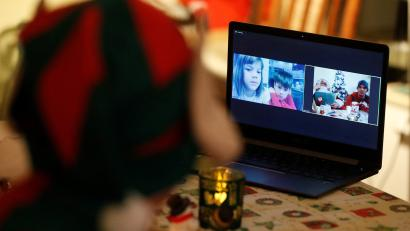 Children are seen on a screen as Santa interacts with them by video, amid the COVID-19 outbreak in Budapest