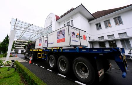 Containers with the coronavirus disease (COVID-19) vaccines from China's Sinovac Biotech Ltd. are seen as they arrive at PT Bio Farma (Persero) in the first shipment to Indonesia in Bandung, West Java province, Indonesia, December 7, 2020.