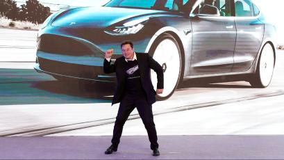 Tesla Inc CEO Elon Musk dances onstage during a delivery event for Tesla China-made Model 3 cars in Shanghai, China January 7, 2020.