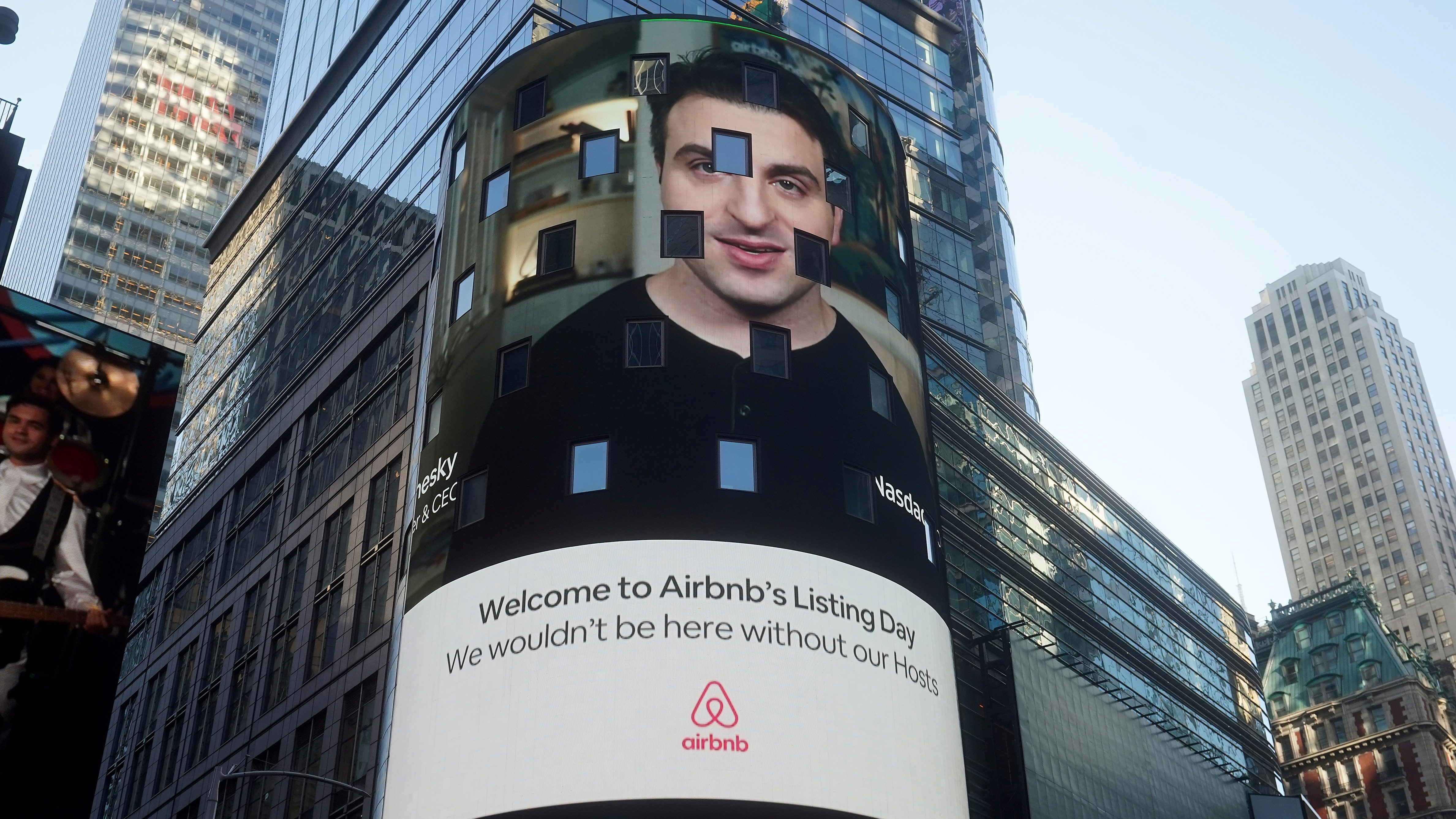 The NASDAQ market site displays an AirBnb sign featuring CEO Brian Chesky on their billboard on the day of their IPO in Times Square in the Manhattan borough of New York City, New York, U.S., December 10, 2020.