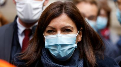 Paris mayor Anne Hidalgo looks on while wearing a mask